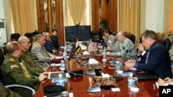Iraq's Defense Minister Khaled al-Obeidi, third left, meets with U.S. Army General Martin Dempsey, third right, chairman of the Joint Chiefs of Staff, at the defense ministry in Baghdad, Saturday, Nov. 15, 2014.