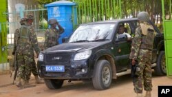 Kenya Defense Forces (KDF) guard the main gate of the Garissa University College compound that was the scene of a recent attack by al-Shabab gunmen, in Garissa, April 6, 2015.