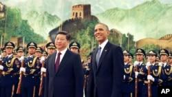 Presiden AS Barack Obama dan Presiden Xi Jinping dalam kunjungan di Beijing, 12 November 2014.