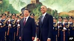 中國國家主席習近平(左)和美國總統奧巴馬2014年在北京人民大會堂