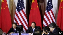 U.S. Treasury Secretary Timothy Geithner, China's Vice Premier Wang Qishan, May 2011 (file photo).