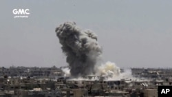 This frame grab from video provided Aug. 13, 2017, by the Ghouta Media Center, a Syrian activist media group, shows smoke and debris rising after a Syrian government ground-to-ground rocket strikes the opposition-held town of Ain Terma, in the Eastern Ghouta suburb of Damascus, Syria.