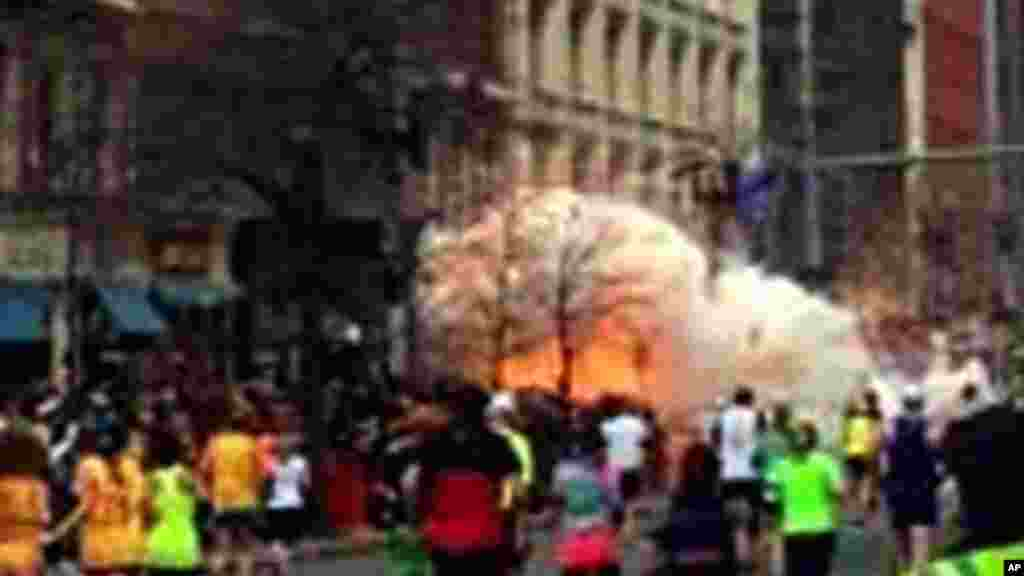 In this image from video provided by WBZ-TV, spectators and runners run from what was described as twin explosions that shook the finish line of the Boston Marathon, April 15, 2013.