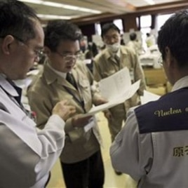 Teams of government and nuclear specialists at the emergency rescue headquarters analyze data from the leaked radiation from the Fukushima nuclear facilitiesin Fukushima, Japan, March 19, 2011