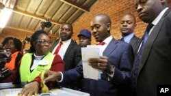 FILE: Zimbabwe's main opposition leader Nelson Chamisa casts his vote at a polling station in Harare, Zimbabwe, Monday, July 30, 2018. Zimbabwe votes in an election that could, if deemed credible, tilt the country toward recovery after years of economic collapse and repression under former leader Robert Mugabe. (AP Photo/Tsvangirayi Mukwazhi)
