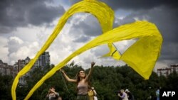 A participant flies a kite during the 'Letatlin N4' annual Festival of Kites, in Moscow, Russia, June 6, 2021.