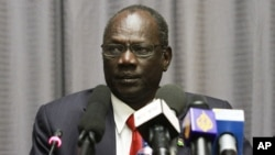 South Sudanese information minister, Michael Makuei Lueth, shown here at a news conference in Addis Ababa last year, says South Sudan needs to restore peace before the alleged perpetrators of violence in the conflict can be held accountable.