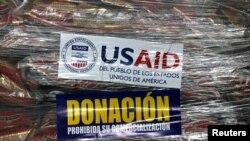 Bantuan kemanusiaan dari USAID untuk Venezuela masih disimpan di sebuah gudang di Kolombia.