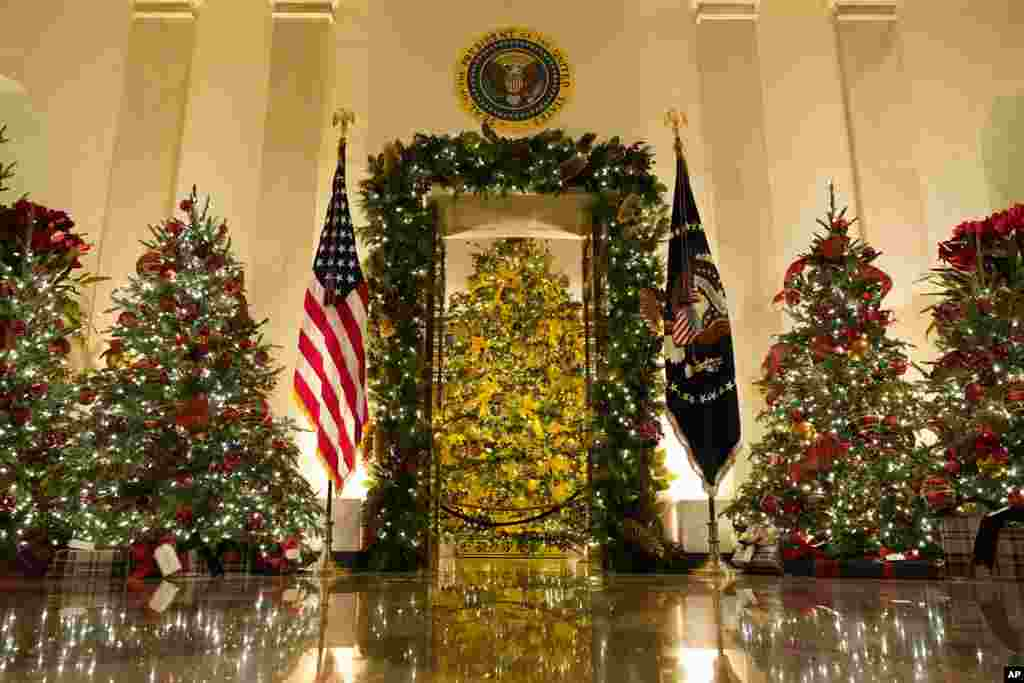 Cross Hall and the Blue Room are decorated during the 2020 Christmas preview at the White House in Washington.