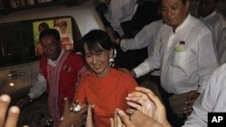 Aung San Suu Kyi is greeted by supporters as she in Burma. (File)