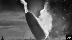 FILE - In this May 6, 1937 file photo, the German dirigible Hindenburg crashes to earth in flames after exploding at the U.S. Naval Station in Lakehurst, N.J. Only one person is left of the 62 passengers and crew who survived when the Hindenburg burst into flames 80 years ago Saturday, May 6, 2017.