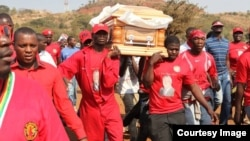 Pall bearers carry the body of the late MDC-T youth, Rebecca Mafikeni, who died while in detention after more than two years in jail.
