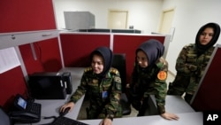 From left, Second Lieutenant Roshan Gul, First Lieutenant Nelofar Frotan and Second Lieutenant Morsal Afshar work at the human resources office in the Ministry of Defense in Kabul, Afghanistan, Oct. 31, 2016.