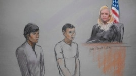FILE - Defendants Azamat Tazhayakov (R) and Dias Kadyrbayev are pictured in a courtroom sketch, appearing in front of a Federal Magistrate at the United States Federal Courthouse in Boston, Massachusetts, May 1, 2013.