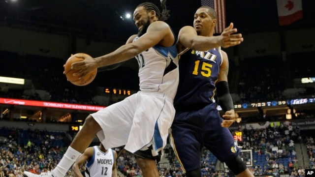 FILE - Minnesota Timberwolves center Ronny Turiaf (L) of France, pulls down a rebound against Utah Jazz center Derrick Favors (15) during the second quarter of an NBA basketball game in Minneapolis.