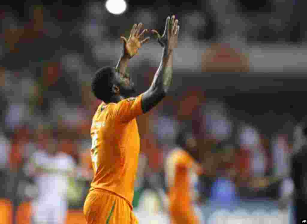 Ivory Coast's Kolo Abib Toure celebrates after they won their African Nations Cup semi-final soccer match against Mali at the Stade De L'Amitie Stadium in Gabon's capital Libreville February 8, 2012.