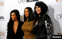 "Singer Cher (R) poses with television personalities Kim Kardashian (C) and Kourtney Kardashian at the premiere of ""The Promise"" in Los Angeles, California, April 12, 2017."