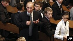 Russian Prime Minister Vladimir Putin speaks at a meeting with election monitors in Moscow, February. 1, 2012.