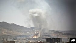 File - Smoke rises after a Saudi-led airstrike hit a site where many believe the largest weapons cache in Yemen's capital, Sana'a, on April 21, 2015.