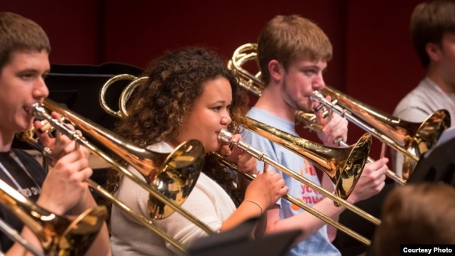 Trombonist Skye Dearborn (center), a member of the 2013 National Youth Orchestra of the United States of America rehearses at SUNY Purchase. (Photo courtesy Chris Lee)