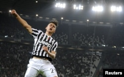 Paulo Dybala célèbre un but à Turin, Italie, le 11 mars 2016. (ARG/Juventus Turin)
