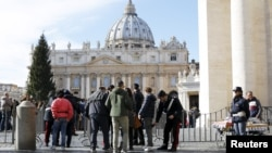 Tourists are inspected as they enter the Vatican in Rome, Italy, Nov. 22, 2015. Rome is bracing for the arrival of millions of pilgrims for the Roman Catholic Holy Year which officials had hoped could revitalize the scandal-plagued city, but which threatens to be more of a headache than a help.