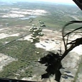 This image taken from video shows relief supplies parachuting from a US Air Force cargo plane flying over Haiti, 19 January 2010 Author: US Air Force