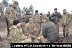 FILE - Ukrainian soldiers learn battle skills such as first aid from U.S. Army troops at the International Peacekeeping and Security Center in western Ukraine.