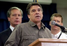 Gov. Rick Perry (C) speaks during a news conference updating information about the state's emergency response to the explosion and fires in West, Texas, April 18, 2013, in Austin, Texas.