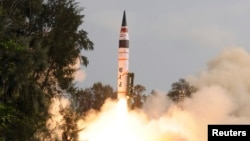 FILE - A surface-to-surface Agni V missile is launched from the Wheeler Island off the eastern Indian state of Odisha.