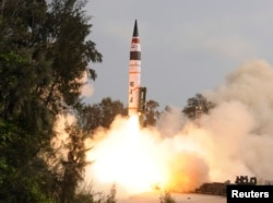 FILE -A surface-to-surface Agni V missile is launched from the Wheeler Island off the eastern Indian state of Odisha April 19, 2012. India test-fired the long range missile capable of reaching deep into China and Europe, thrusting the emerging Asian power into an elite club of nations with intercontinental nuclear weapons capabilities.