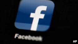 FILE - The Facebook logo is displayed on an iPad in Philadelphia, May 16, 2012.
