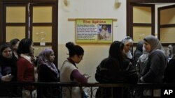 Egyptian women queue to vote in a polling station in Cairo, Egypt, Monday, Nov. 28, 2011