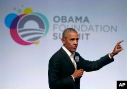 Former President Barack Obama addresses a crowd during the first session of the Obama Foundation Summit in Chicago, Oct. 31, 2017.