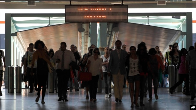 Commuters arrive at Lisbon's Terreiro do Paco ferry station, July 3, 2013. Portugal's financial markets went into a steep nosedive Wednesday as the government teetered on the verge of collapse.