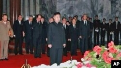 New North Korean ruler Kim Jong Un pays respects to his father and former leader Kim Jong Il, Pyongyang, Dec. 20, 2011.