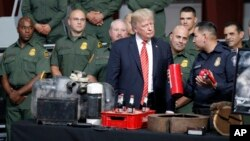 President Donald Trump is shown methods of narcotics smuggling during a tour of U.S. Customs and Border Protection Border equipment at their airport hanger at Marine Corps Air Station Yuma, Aug. 22, 2017, in Yuma, Arizona.