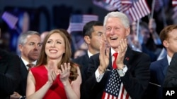Chelsea Clinton and former President Bill Clinton applaud as Democratic presidential nominee Hillary Clinton speaks during the final day of the Democratic National Convention in Philadelphia, July 28, 2016.