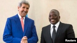 President of the Democratic Republic of Congo (DRC) Joseph Kabila (R) welcomes U.S. Secretary of State John Kerry at the Palais de la Nation in Kinshasa May 4, 2014.
