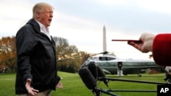 President Donald Trump answers a question from a member of the media as he leaves the White House, Nov. 17, 2018, in Washington.