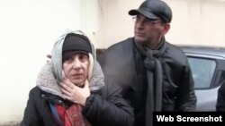 FILE - Azerbaijani rights activist Leyla Yunus walks with her husband Arif Yunus after she was released from prison in Baku, Azerbaijan, Dec. 9, 2015.