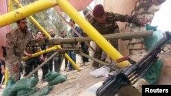 이라크 보안군이 바그다드에서 1백15km 떨어진 곳에서 ISIL의 공격에 대비하고 있다.