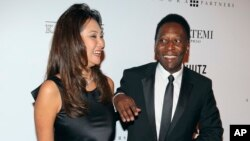FILE - Brazilian soccer great Pele and businesswoman Marcia Cibele Aoki pose on the red carpet of The Foundation for AIDS Research event in Sao Paulo, Brazil, April 5 2013.