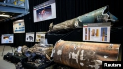"""FILE - A U.S. Department of Defense exhibit shows a """"Qiam"""" ballistic missile manufactured in Iran, at a military base in Washington, Nov. 29, 2018."""