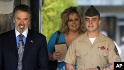 Marine Corps Sgt. Frank D. Wuterich arrives for a pre-trial hearing with his lawyer Neal A. Puckett and girlfriend Melissa Balcombe at Camp Pendleton, California March 22, 2010.