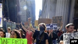Protesters with Occupy Wall Street march up Broadway from Zuccotti Park to Washington Square Park in New York on Saturday, Oct. 8, 2011. The Occupy Wall Street movement started in New York City last month and is spreading to other parts of the country. (A