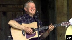 Master flatpicker Doc Watson performs at the annual Merlefest at Wilkes Comunity College in Wilkesboro, N.C. (2001 file photo)