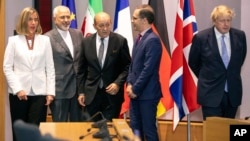 EU foreign policy chief Federica Mogherini, Iranian Foreign Minister Javad Zarif, French Foreign Minister Jean-Yves Le Drian, German Foreign Minister Heiko Maas, British Foreign Secretary Boris Johnson in Brussels, May 15, 2018.