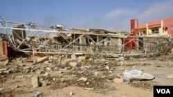 Baraguzan gidajen da aka ruguza a Mosul