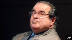 In this Oct. 18, 2011 file photo, U.S. Supreme Court justice Antonin Scalia looks into the balcony before addressing the Chicago-Kent College Law justice in Chicago.